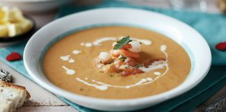Spicy seafood bisque with garlic prawns Easy Food