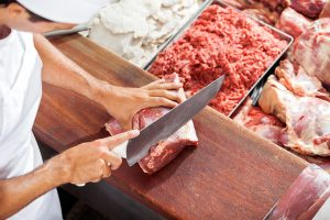 Butcher portioning meat Easy Food