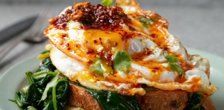 Crispy fried eggs with peanut rayu and greens