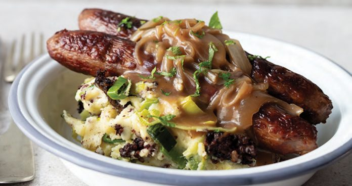 Venison bangers and black pudding leek mash with stout and onion gravy
